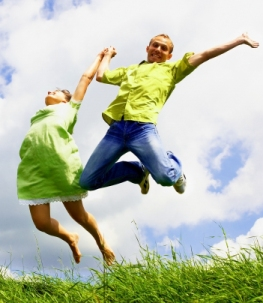 shutterstock 35183707 couple in green jumping up